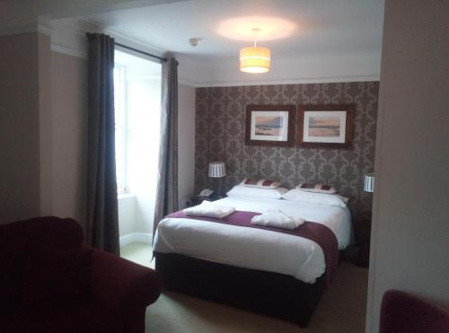 A bed or beds in a room at The Grove Hotel