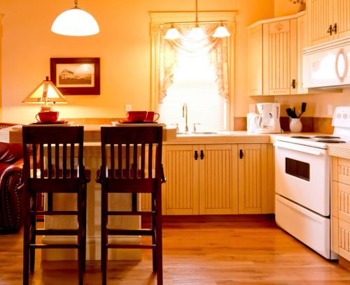 A kitchen or kitchenette at Third Mission Heritage Suites