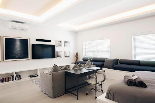 A television and/or entertainment center at Executive Beachside Loft - A Bondi Beach Holiday Home