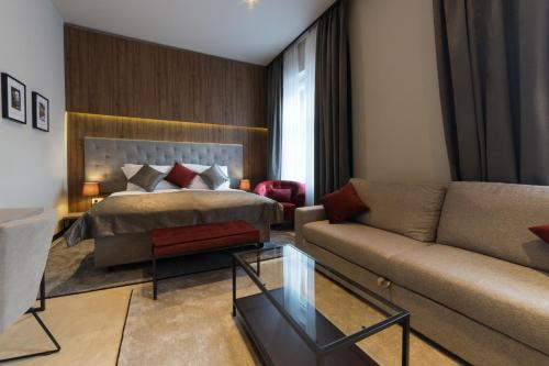 A bed or beds in a room at Dežman Luxury Center