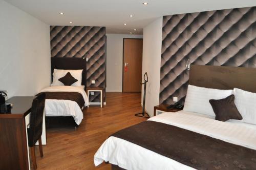 Ein Bett oder Betten in einem Zimmer der Unterkunft Hotel de Savoie