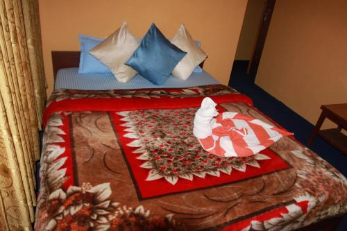 A bed or beds in a room at Pushkar Backpackers Inn Pokhara