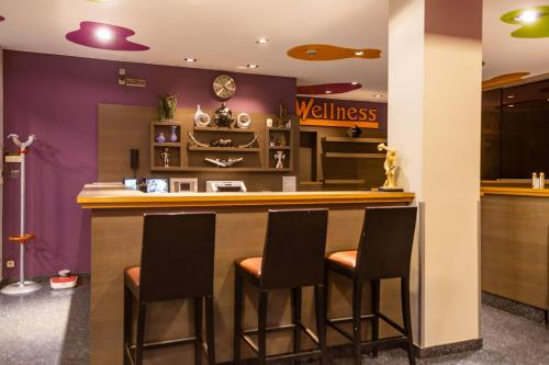Ο χώρος του lounge ή του μπαρ στο Wellness Apart Hotel