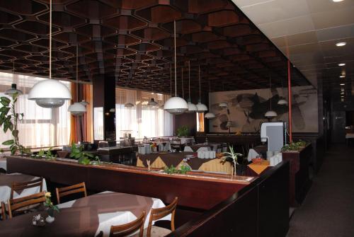 Ein Restaurant oder anderes Speiselokal in der Unterkunft Hotel Labe