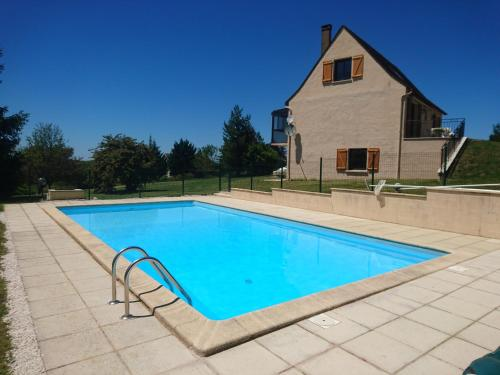 The swimming pool at or near Les Bories