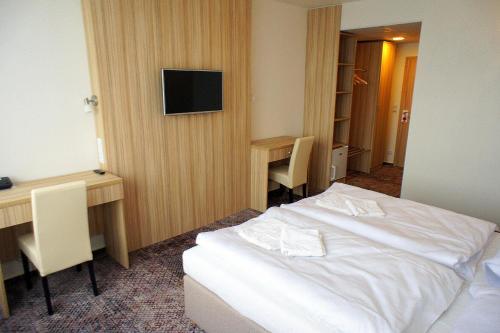 Ein Bett oder Betten in einem Zimmer der Unterkunft Hotel Labe