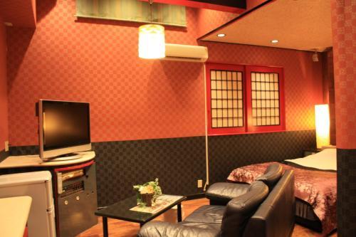 レステイ MOON高知(大人専用)にあるテレビまたはエンターテインメントセンター