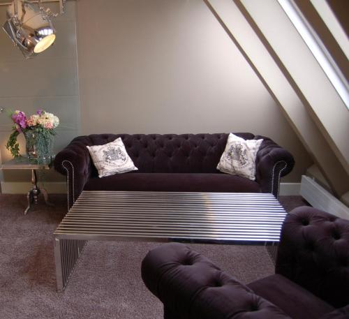 A seating area at Boutique-Hotel & Boardinghouse GEORGES