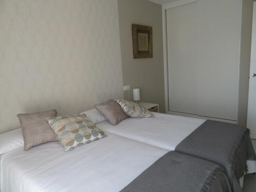 Cama o camas de una habitación en Alcañiz Flats II