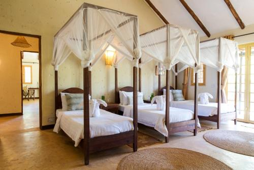A bed or beds in a room at Kili Villa