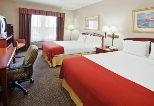 A bed or beds in a room at Holiday Inn Express- West Sacramento