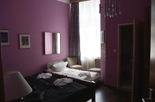 Un ou plusieurs lits dans un hébergement de l'établissement Hotel Pension Ingeborg