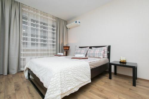 Кровать или кровати в номере 5days-nn, Апартаменты на Карла Маркса 45