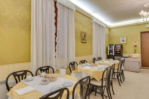 Um restaurante ou outro lugar para comer em Hotel Universo & Nord