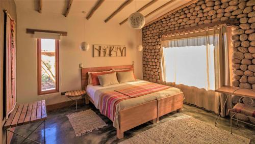 Una cama o camas en una habitación de Casita La Brea