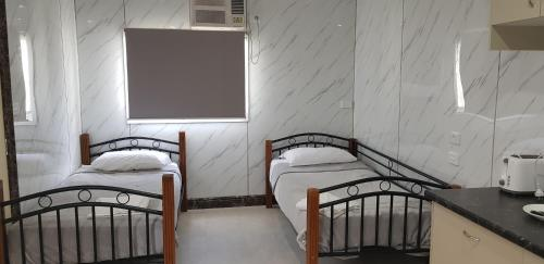A bed or beds in a room at Bellhaven Park