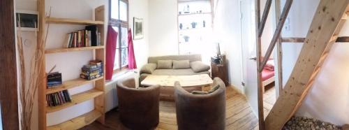 A seating area at Ferienhaus Bonn