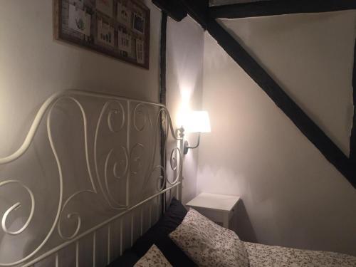 Cama o camas de una habitación en Apartamentos El Greco