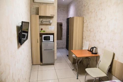 Кухня или мини-кухня в Bolshaya Morskaya 7