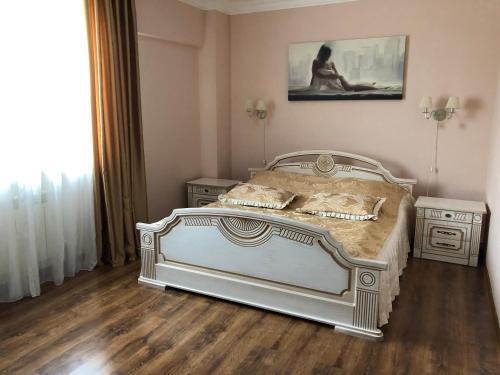 Кровать или кровати в номере Гостиница Стрелец
