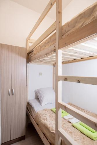 A bunk bed or bunk beds in a room at Adjiutant Mini-hotel