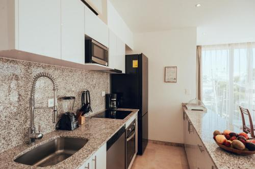 A kitchen or kitchenette at Antera Hotel & Residences