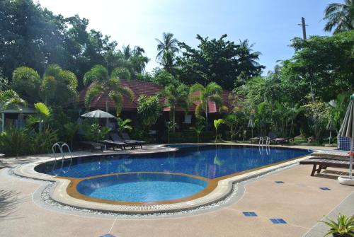 Der Swimmingpool an oder in der Nähe von Mac's Bay Resort