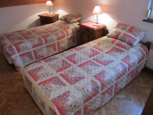 A bed or beds in a room at Gite de Grandvillars
