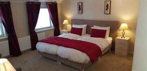 Ein Bett oder Betten in einem Zimmer der Unterkunft Bed and Breakfast Katwijk