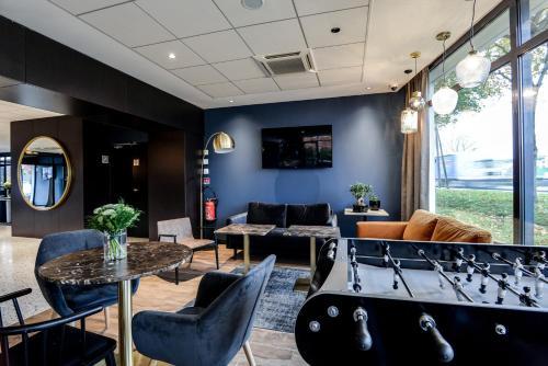 Restaurant ou autre lieu de restauration dans l'établissement Brit Hotel Du Stade Rennes Ouest
