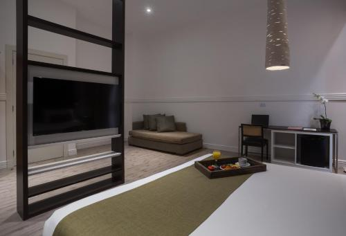A television and/or entertainment center at Esplendor by Wyndham Savoy Rosario
