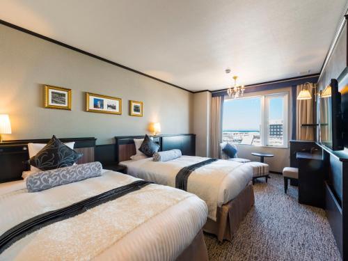 Tempat tidur dalam kamar di Hotel Sonia Otaru