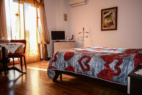 Letto o letti in una camera di B&B Mariposa