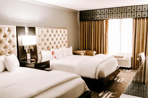 A bed or beds in a room at Wyndham Garden Dallas North