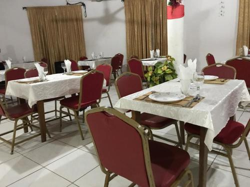 A restaurant or other place to eat at Hotel Touristique de Koza