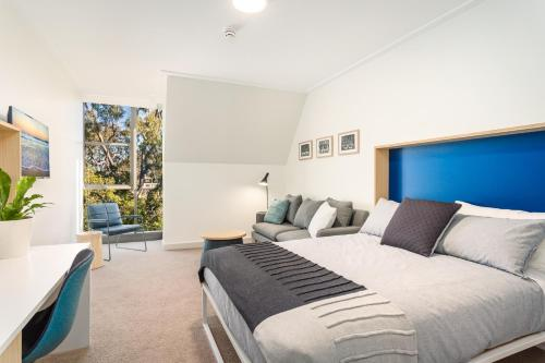 A bed or beds in a room at St Paul's Serviced Accommodation
