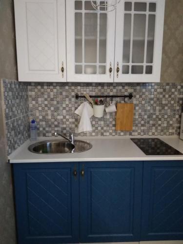Кухня или мини-кухня в Апартаменты на Франциска Скорины 26