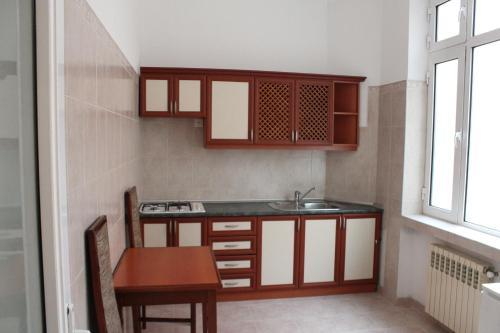 A cozinha ou cozinha compacta de Astoria Hotel