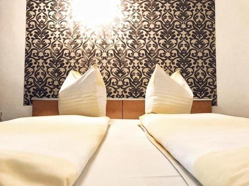 Кровать или кровати в номере Reich Motel