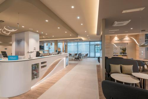 The lobby or reception area at Hampton By Hilton Frankfurt Airport