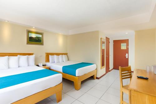 Un ou plusieurs lits dans un hébergement de l'établissement Best Western Jaco Beach All Inclusive Resort