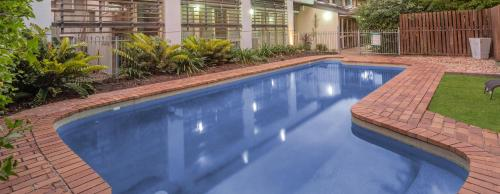 The swimming pool at or near Airport International Hotel Brisbane