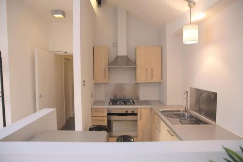 A kitchen or kitchenette at Stunning Northern Quarter Loft Conversion