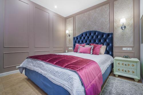 Кровать или кровати в номере Апартаменты Лотте 24