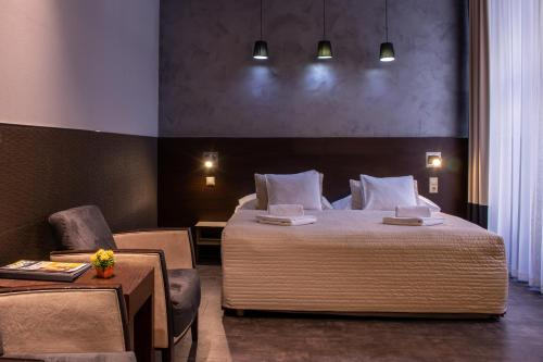 A bed or beds in a room at Carat Boutique Hotel