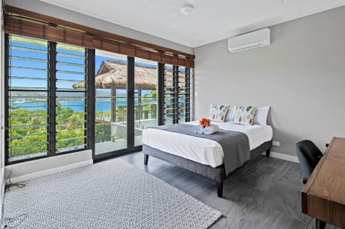 A bed or beds in a room at Mandalay Luxury Retreat
