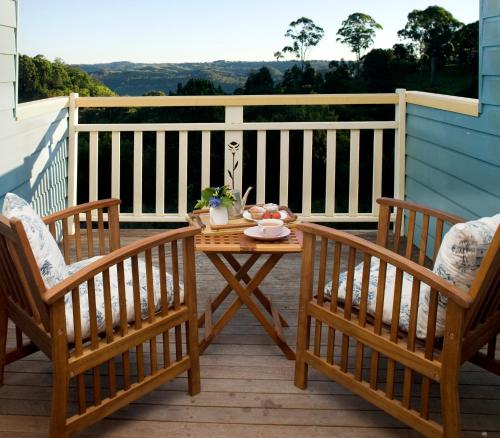 A balcony or terrace at The Spotted Chook and Amelie's Petite Maison