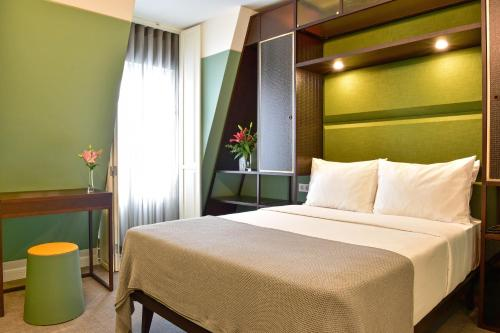 A bed or beds in a room at My Story Hotel Augusta