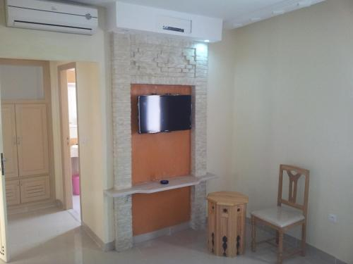 A television and/or entertainment center at Résidence El Arich