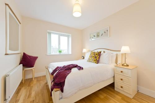 A bed or beds in a room at Pearse Street Suites